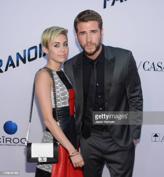 Miley Cyrus and Liam Hemsworth attend the premiere of Relativity Media's 'Paranoia' at DGA Theater on August 8 2013 in Los Angeles California