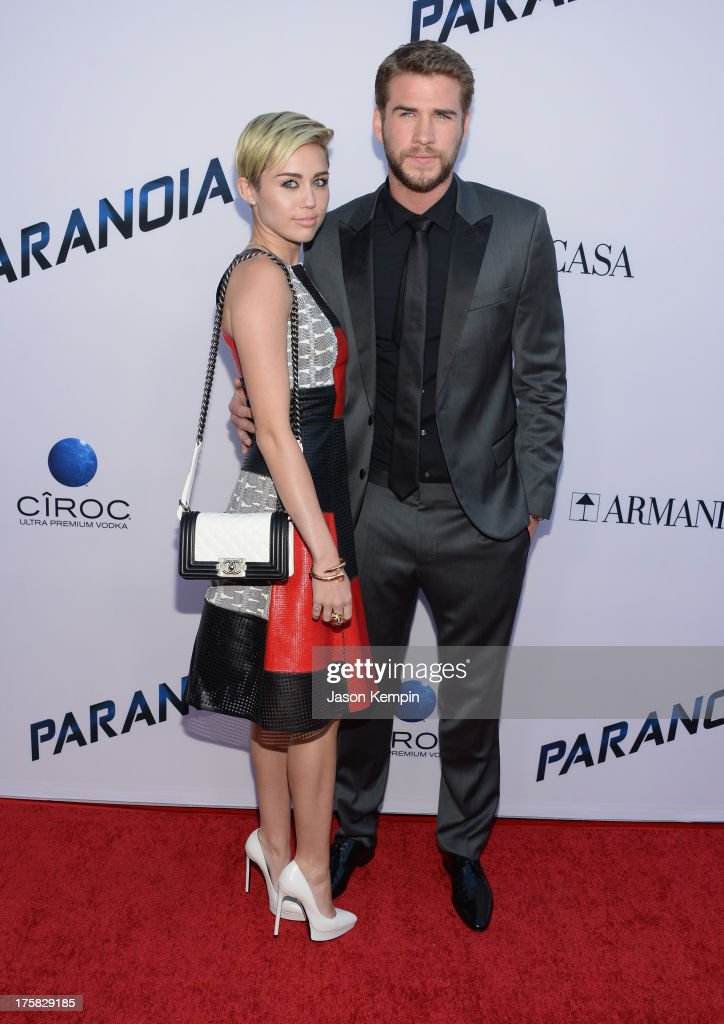 <a gi-track='captionPersonalityLinkClicked' href=/galleries/search?phrase=Miley+Cyrus&family=editorial&specificpeople=3973523 ng-click='$event.stopPropagation()'>Miley Cyrus</a> and <a gi-track='captionPersonalityLinkClicked' href=/galleries/search?phrase=Liam+Hemsworth&family=editorial&specificpeople=6338547 ng-click='$event.stopPropagation()'>Liam Hemsworth</a> attend the premiere of Relativity Media's 'Paranoia' at DGA Theater on August 8, 2013 in Los Angeles, California.