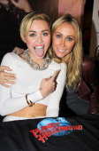 Miley Cyrus and mother Tish Cyrus attend the Miley Cyrus 'Bangerz' Record Release Signing at Planet Hollywood Times Square on October 8 2013 in New...