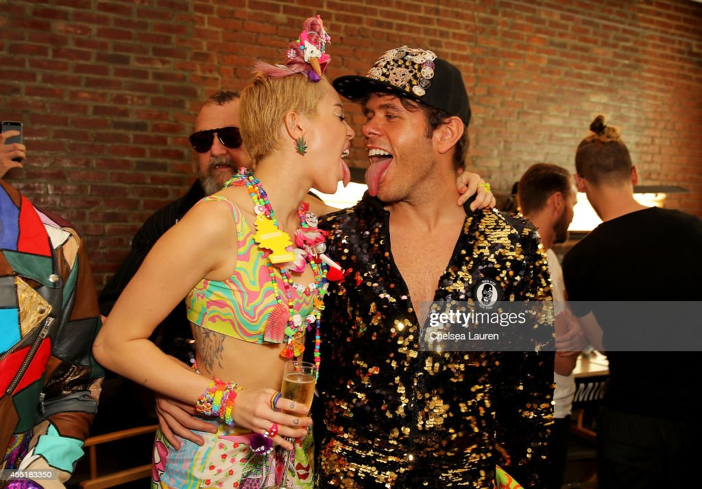 Miley Cyrus and Perez Hilton pose baskstage at Jeremy Scott fashion show during MADE Fashion Week Spring 2015 at Milk Studios on September 10 2014 in...