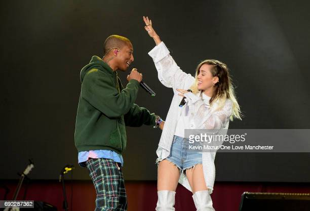 Miley Cyrus and Pharrell Williams perform on stage during the One Love Manchester Benefit Concert at Old Trafford Cricket Ground on June 4 2017 in...