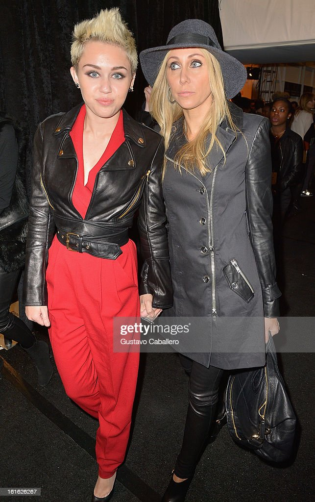 <a gi-track='captionPersonalityLinkClicked' href=/galleries/search?phrase=Miley+Cyrus&family=editorial&specificpeople=3973523 ng-click='$event.stopPropagation()'>Miley Cyrus</a> and Tish Cyrus is seen around Lincoln Center - Day 7 - Fall 2013 Mercedes-Benz Fashion Week at Lincoln Center for the Performing Arts on February 13, 2013 in New York City.