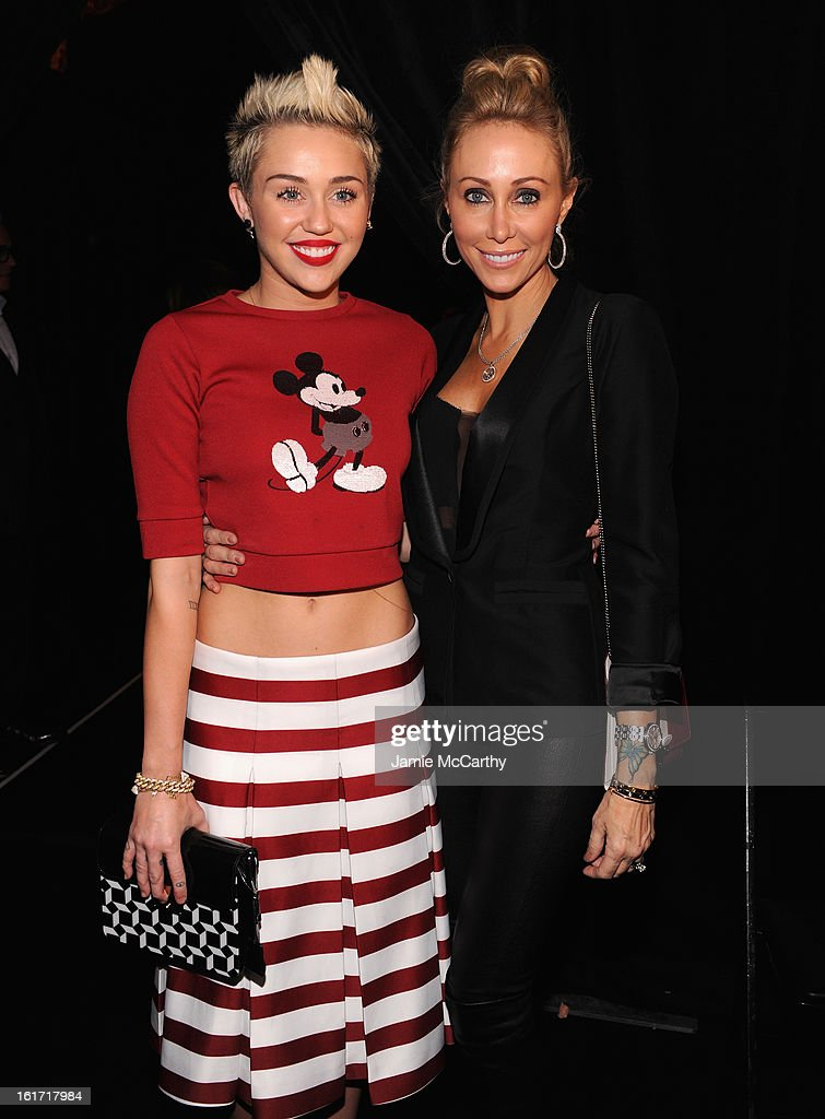 <a gi-track='captionPersonalityLinkClicked' href=/galleries/search?phrase=Miley+Cyrus&family=editorial&specificpeople=3973523 ng-click='$event.stopPropagation()'>Miley Cyrus</a> (L) and Tish Cyrus pose backstage at the Marc Jacobs Collection Fall 2013 fashion show during Mercedes-Benz Fashion Week at New York Armory on February 14, 2013 in New York City.