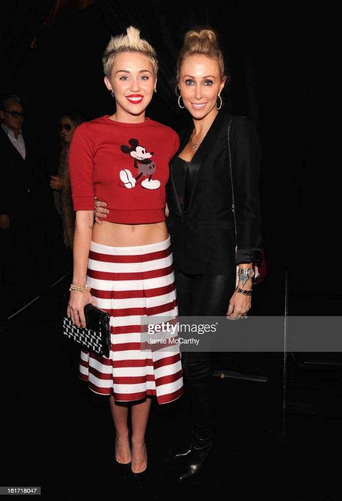 Miley Cyrus (L) and Tish Cyrus pose backstage at the Marc Jacobs Collection Fall 2013 fashion show during Mercedes-Benz Fashion Week at New York Armory on February 14, 2013 in New York City.