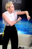 Miley Cyrus applies AXE deodorant backstage at Z100's Jingle Ball 2013 presented by Aeropostale at Madison Square Garden on December 13 2013 in New...