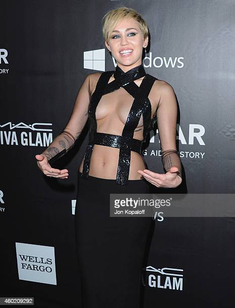 Miley Cyrus arrives at the 2014 amfAR LA Inspiration Gala at Milk Studios on October 29 2014 in Hollywood California