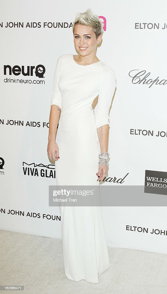 <a gi-track='captionPersonalityLinkClicked' href=/galleries/search?phrase=Miley+Cyrus&family=editorial&specificpeople=3973523 ng-click='$event.stopPropagation()'>Miley Cyrus</a> arrives at the 21st Annual Elton John AIDS Foundation Academy Awards viewing party held at West Hollywood Park on February 24, 2013 in West Hollywood, California.