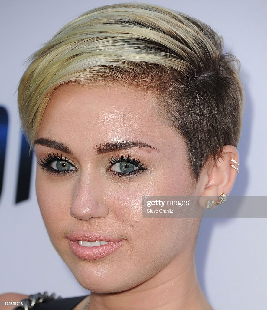 <a gi-track='captionPersonalityLinkClicked' href=/galleries/search?phrase=Miley+Cyrus&family=editorial&specificpeople=3973523 ng-click='$event.stopPropagation()'>Miley Cyrus</a> arrives at the 'Paranoia' - Los Angeles Premiere at DGA Theater on August 8, 2013 in Los Angeles, California.