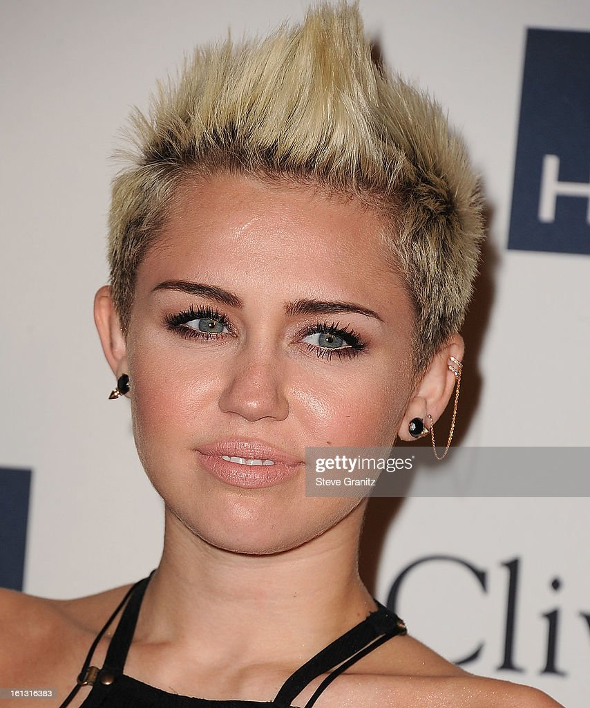 <a gi-track='captionPersonalityLinkClicked' href=/galleries/search?phrase=Miley+Cyrus&family=editorial&specificpeople=3973523 ng-click='$event.stopPropagation()'>Miley Cyrus</a> arrives at the The 55th Annual GRAMMY Awards - Pre-GRAMMY Gala And Salute To Industry Icons Honoring L.A. Reid on February 9, 2013 in Los Angeles, California.