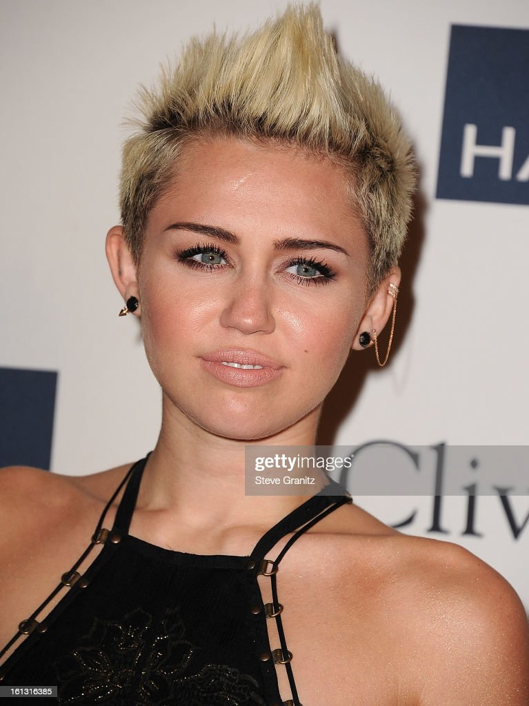 Miley Cyrus arrives at the The 55th Annual GRAMMY Awards - Pre-GRAMMY Gala And Salute To Industry Icons Honoring L.A. Reid on February 9, 2013 in Los Angeles, California.
