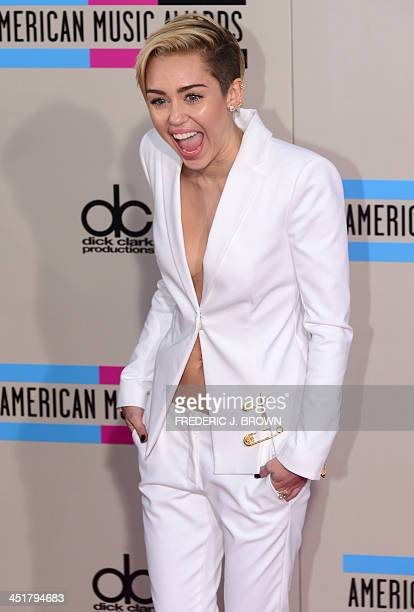 Miley Cyrus arrives for the 2013 American Music Awards at the Nokia Theatre LA Live in downtown Los Angeles California November 24 2013 AFP PHOTO /...