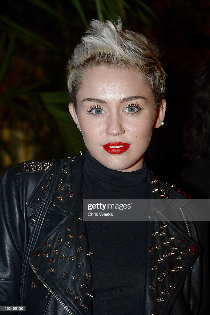 <a gi-track='captionPersonalityLinkClicked' href=/galleries/search?phrase=Miley+Cyrus&family=editorial&specificpeople=3973523 ng-click='$event.stopPropagation()'>Miley Cyrus</a> attends an after party for Mario Testino's PRISM reception at a private residence on February 23, 2013 in Beverly Hills, California.