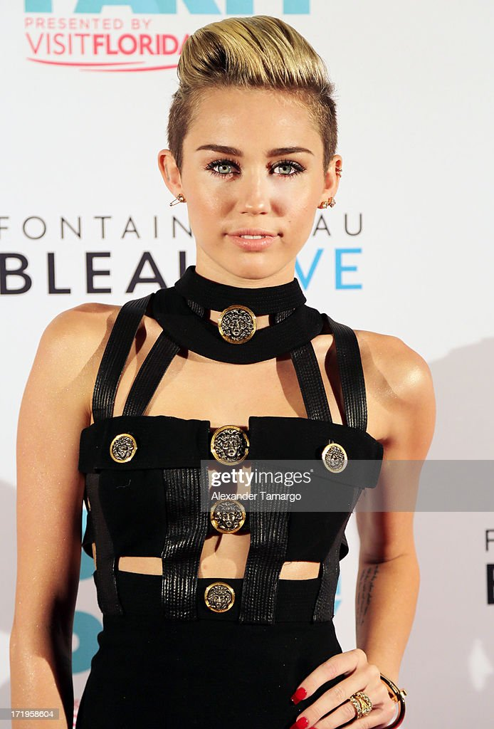 <a gi-track='captionPersonalityLinkClicked' href=/galleries/search?phrase=Miley+Cyrus&family=editorial&specificpeople=3973523 ng-click='$event.stopPropagation()'>Miley Cyrus</a> attends iHeartRadio Ultimate Pool Party Presented By VISIT FLORIDA at Fontainebleau Miami Beach on June 29, 2013 in Miami Beach, Florida.