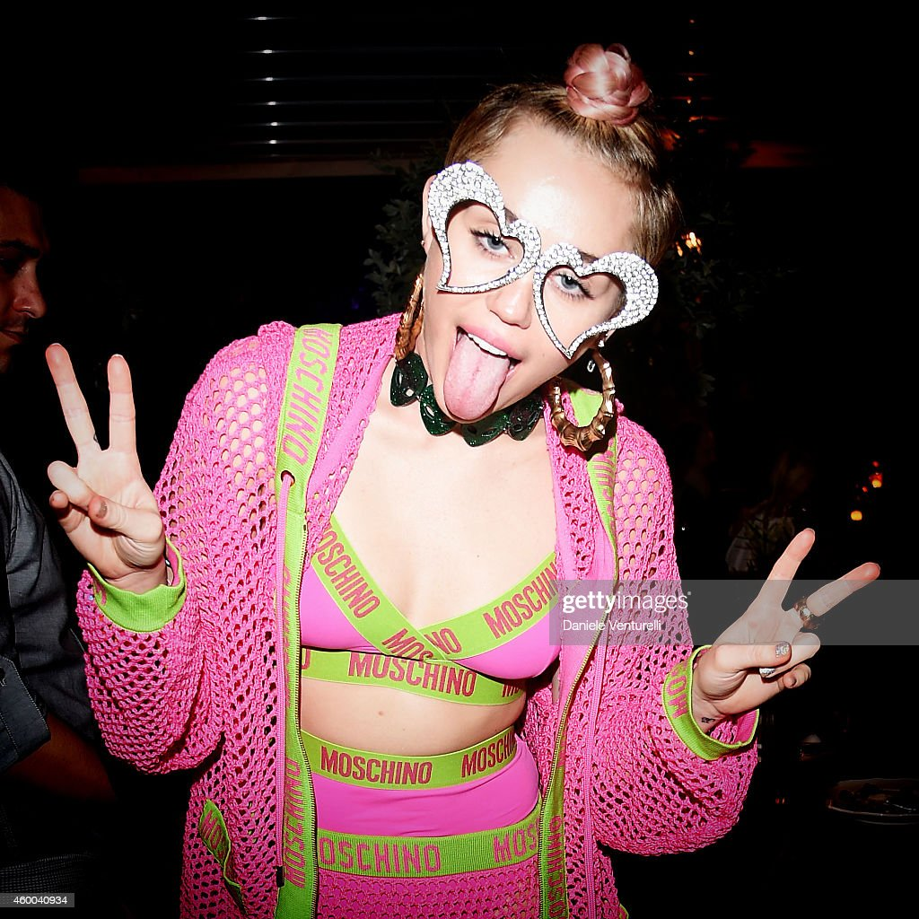 Miley Cyrus attends Jeremy Scott Moschino Party with Barbie on December 4 2014 in Miami Beach Florida