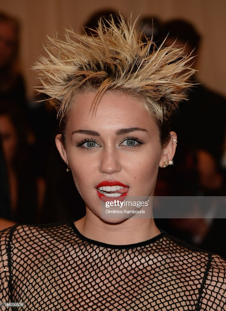 Miley Cyrus attends the 2013 Costume Institute Gala PUNK Chaos to Couture at Metropolitan Museum of Art on May 6 2013 in New York City