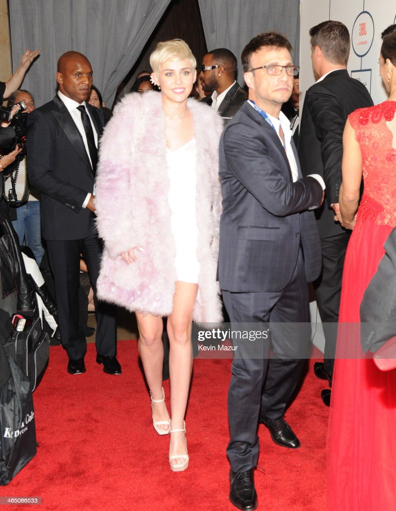 <a gi-track='captionPersonalityLinkClicked' href=/galleries/search?phrase=Miley+Cyrus&family=editorial&specificpeople=3973523 ng-click='$event.stopPropagation()'>Miley Cyrus</a> attends the 56th annual GRAMMY Awards Pre-GRAMMY Gala and Salute to Industry Icons honoring Lucian Grainge at The Beverly Hilton on January 25, 2014 in Los Angeles, California.
