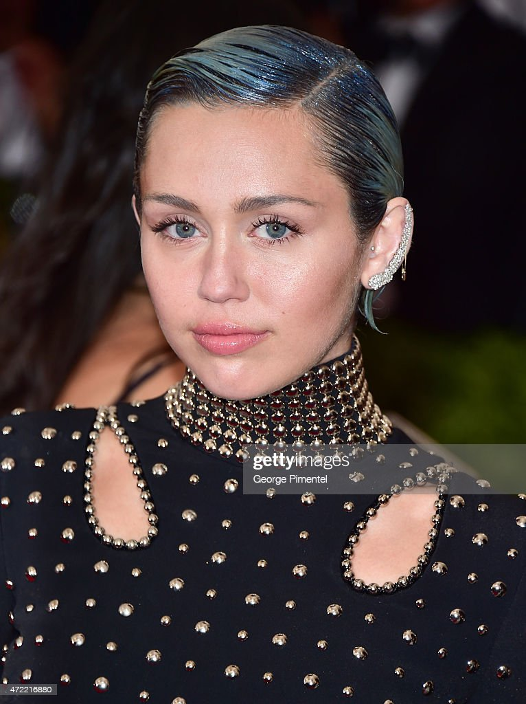 <a gi-track='captionPersonalityLinkClicked' href=/galleries/search?phrase=Miley+Cyrus&family=editorial&specificpeople=3973523 ng-click='$event.stopPropagation()'>Miley Cyrus</a> attends the 'China: Through The Looking Glass' Costume Institute Benefit Gala at Metropolitan Museum of Art on May 4, 2015 in New York City.