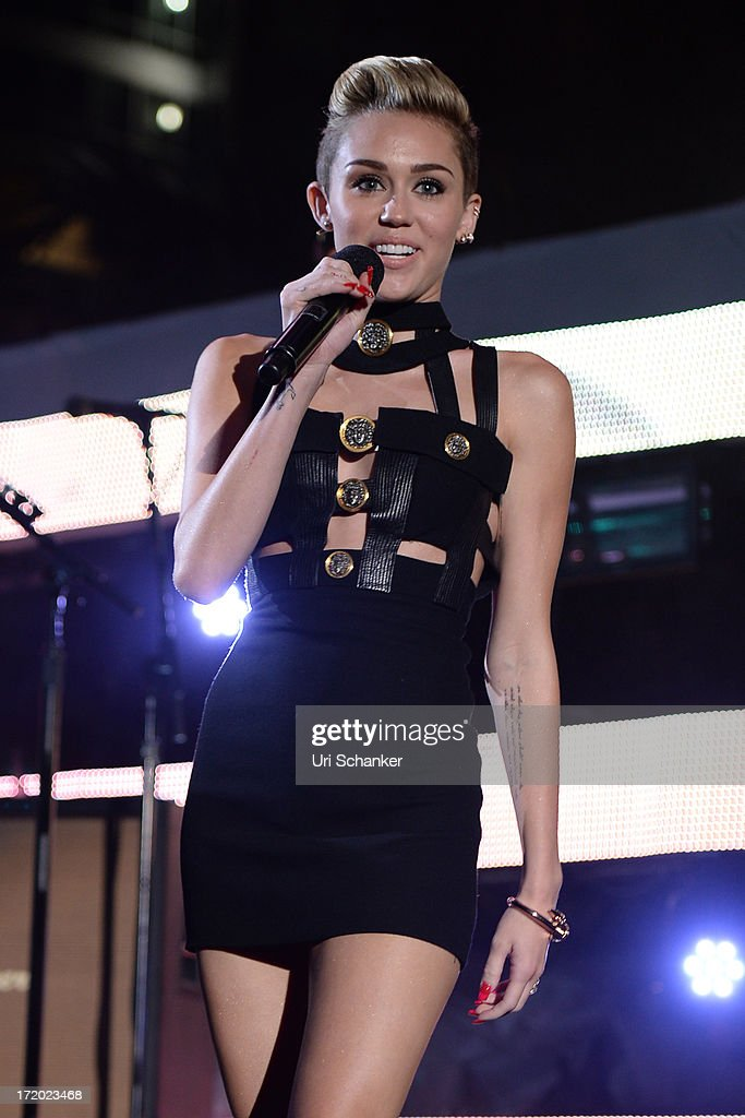 <a gi-track='captionPersonalityLinkClicked' href=/galleries/search?phrase=Miley+Cyrus&family=editorial&specificpeople=3973523 ng-click='$event.stopPropagation()'>Miley Cyrus</a> attends the iHeartRadio Ultimate Pool Party Presented By VISIT FLORIDA At Fontainebleau's BleauLive at Fontainebleau Miami Beach on June 29, 2013 in Miami Beach, Florida.