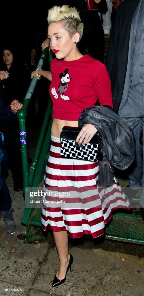 Miley Cyrus attends the Marc Jacobs Fall 2013 Mercedes-Benz Fashion Show at N.Y. State Armory on February 14, 2013 in New York City.