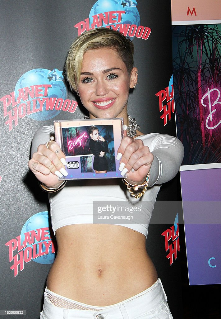 <a gi-track='captionPersonalityLinkClicked' href=/galleries/search?phrase=Miley+Cyrus&family=editorial&specificpeople=3973523 ng-click='$event.stopPropagation()'>Miley Cyrus</a> attends the <a gi-track='captionPersonalityLinkClicked' href=/galleries/search?phrase=Miley+Cyrus&family=editorial&specificpeople=3973523 ng-click='$event.stopPropagation()'>Miley Cyrus</a> 'Bangerz' Record Release Signing at Planet Hollywood Times Square on October 8, 2013 in New York City.