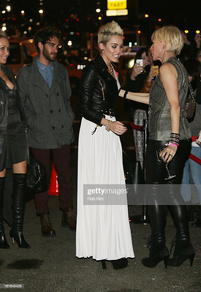 <a gi-track='captionPersonalityLinkClicked' href=/galleries/search?phrase=Miley+Cyrus&family=editorial&specificpeople=3973523 ng-click='$event.stopPropagation()'>Miley Cyrus</a> attends the <a gi-track='captionPersonalityLinkClicked' href=/galleries/search?phrase=Miley+Cyrus&family=editorial&specificpeople=3973523 ng-click='$event.stopPropagation()'>Miley Cyrus</a> March 'Cosmo' Cover Issue Celebration at Acme on February 13, 2013 in New York City.