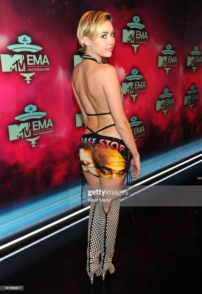 <a gi-track='captionPersonalityLinkClicked' href=/galleries/search?phrase=Miley+Cyrus&family=editorial&specificpeople=3973523 ng-click='$event.stopPropagation()'>Miley Cyrus</a> attends the MTV EMA's 2013 at the Ziggo Dome on November 10, 2013 in Amsterdam, Netherlands.
