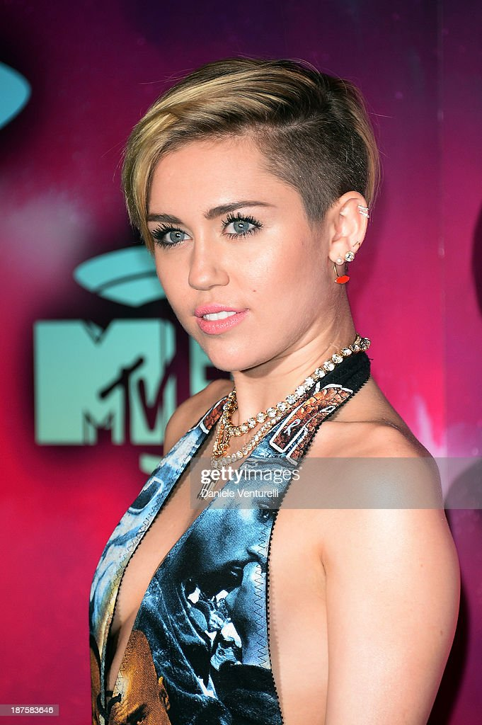 <a gi-track='captionPersonalityLinkClicked' href=/galleries/search?phrase=Miley+Cyrus&family=editorial&specificpeople=3973523 ng-click='$event.stopPropagation()'>Miley Cyrus</a> attends the MTV EMA's 2013 at Ziggo Dome on November 10, 2013 in Amsterdam, Netherlands.