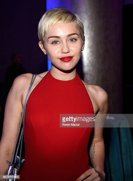 Miley Cyrus attends the PreGRAMMY Gala And Salute To Industry Icons Honoring Martin Bandier at The Beverly Hilton on February 7 2015 in Los Angeles...