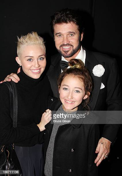 Miley Cyrus Billy Ray Cyrus and Noah Cyrus pose backstage at the hit musical 'Chicago' on Broadway at The Ambassador Theater on November 18 2012 in...