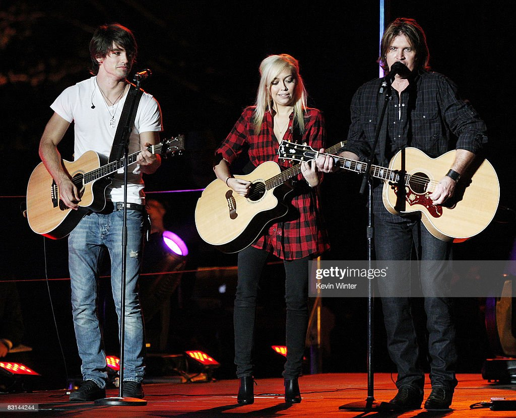 Miley Cyrus' boyfriend, Musician Justin Gaston (L), Miley's sister, musician Brandi Cyrus and actor/singer Billy Ray Cyrus perform at Miley Cyrus' 'Sweet 16' birthday celebration benefiting Youth Service America at Disneyland on October 5, 2008 in Anaheim, California.