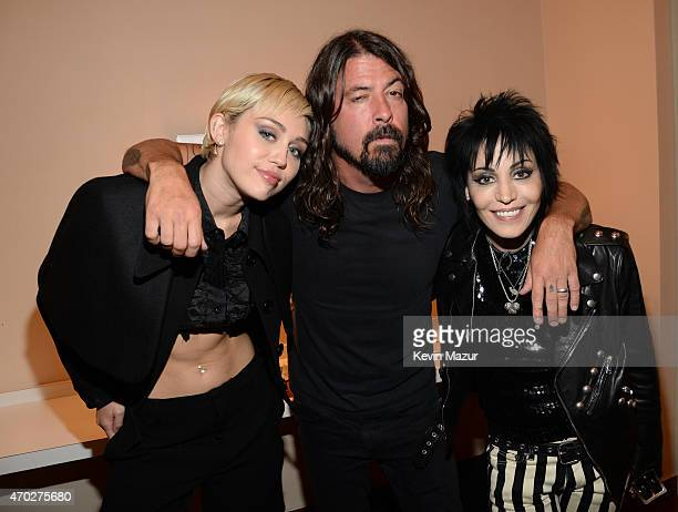 Miley Cyrus Dave Grohl and Joan Jett attend the 30th Annual Rock And Roll Hall Of Fame Induction Ceremony at Public Hall on April 18 2015 in...