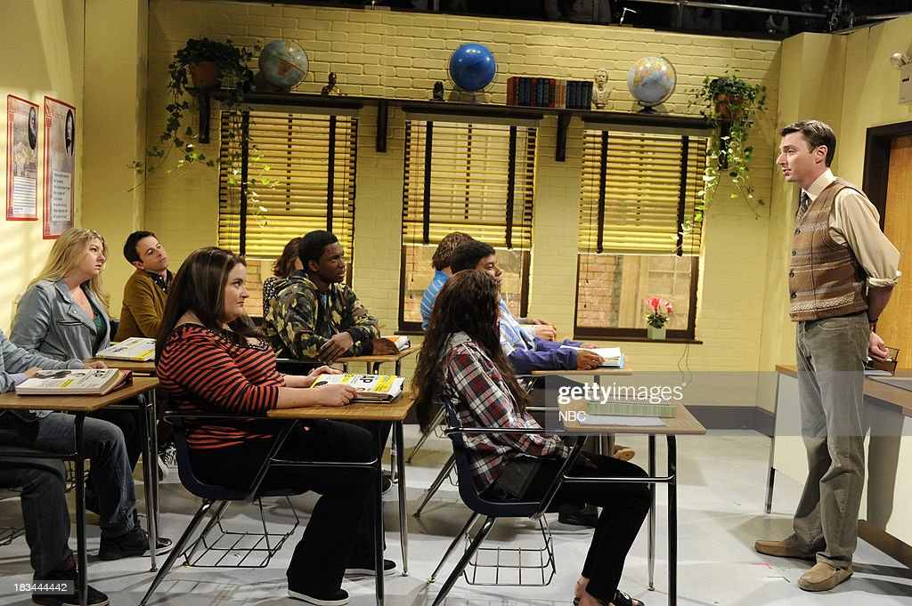LIVE -- 'Miley Cyrus' Episode 1643 -- Pictured: (l-r) Aidy Bryant as student, Jay Pharoah as student, Miley Cyrus as student, Mike O'Brien as teacher during the 'Poetry Class' sketch --