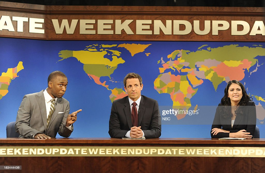 LIVE -- 'Miley Cyrus' Episode 1643 -- Pictured: (l-r) Jay Pharoah as Shannon Sharpe, <a gi-track='captionPersonalityLinkClicked' href=/galleries/search?phrase=Seth+Meyers&family=editorial&specificpeople=618859 ng-click='$event.stopPropagation()'>Seth Meyers</a>, <a gi-track='captionPersonalityLinkClicked' href=/galleries/search?phrase=Cecily+Strong&family=editorial&specificpeople=9951067 ng-click='$event.stopPropagation()'>Cecily Strong</a> during 'Weekend Update' --