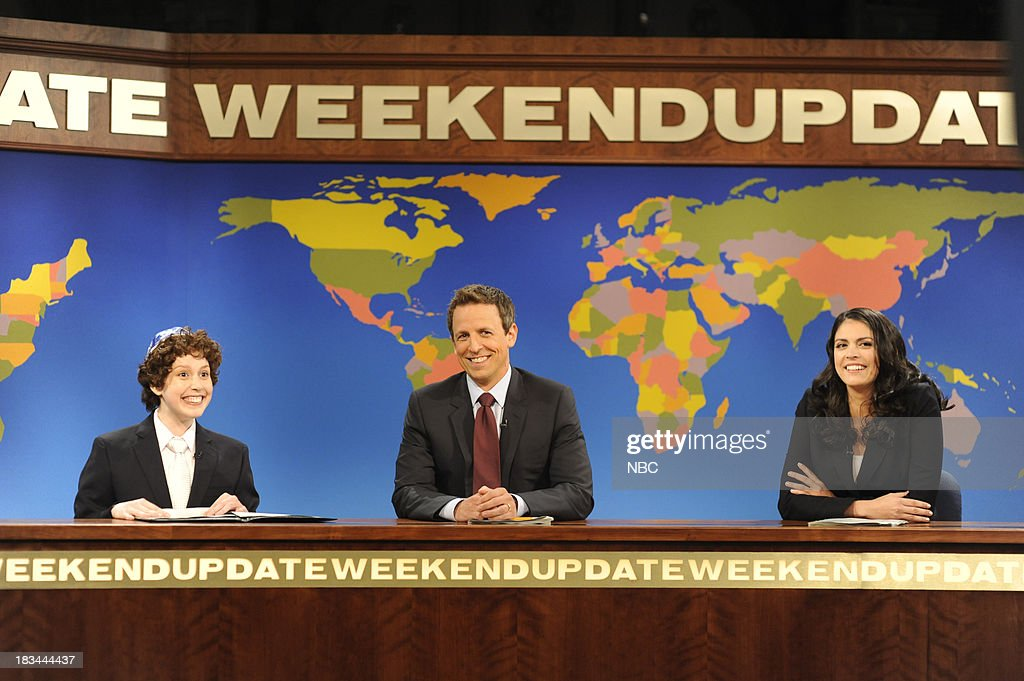 LIVE -- 'Miley Cyrus' Episode 1643 -- Pictured: (l-r) Vanessa Bayer as Jacob the Bar Mitzvah Boy, <a gi-track='captionPersonalityLinkClicked' href=/galleries/search?phrase=Seth+Meyers&family=editorial&specificpeople=618859 ng-click='$event.stopPropagation()'>Seth Meyers</a>, <a gi-track='captionPersonalityLinkClicked' href=/galleries/search?phrase=Cecily+Strong&family=editorial&specificpeople=9951067 ng-click='$event.stopPropagation()'>Cecily Strong</a> during 'Weekend Update' --