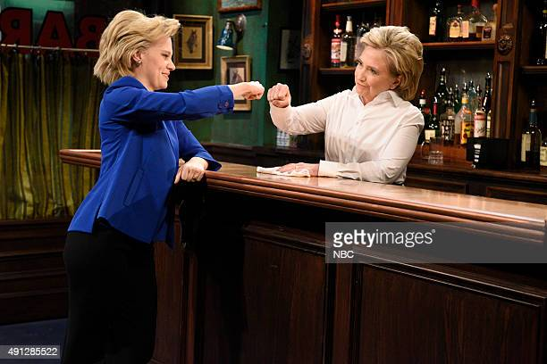 LIVE 'Miley Cyrus' Episode 1684 Pictured Kate McKinnon as Hillary Clinton and Hillary Clinton a Val during the 'Bar Talk' sketch on October 3 2015
