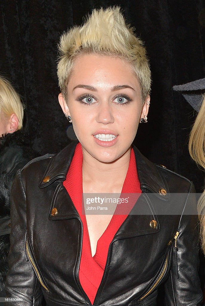 <a gi-track='captionPersonalityLinkClicked' href=/galleries/search?phrase=Miley+Cyrus&family=editorial&specificpeople=3973523 ng-click='$event.stopPropagation()'>Miley Cyrus</a> is seen during Fall 2013 Mercedes-Benz Fashion Week at Lincoln Center for the Performing Arts on February 13, 2013 in New York City.