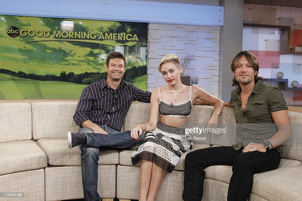 AMERICA - Miley Cyrus, Keith Urban and Ryan Seacrest are guests on 'Good Morning America,' 7/15/13, airing on the ABC Television Network. (Photo by Lou Rocco/ABC via Getty Images) RYAN