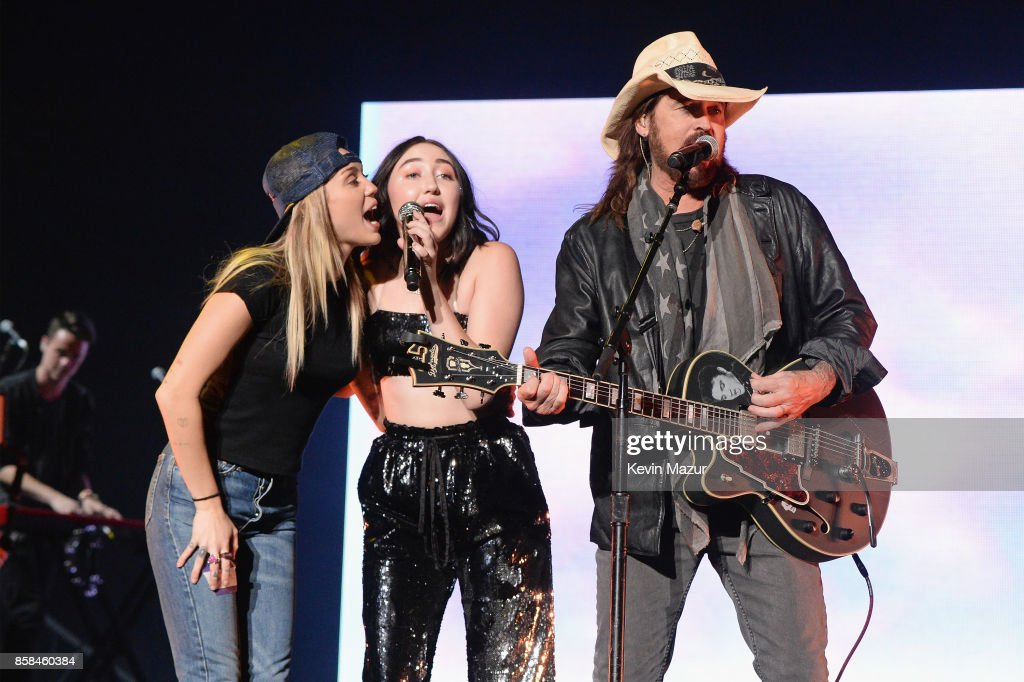 Miley Cyrus, Noah Cyrus, and Billy Ray Cyrus perform onstage during Katy Perry 'Witness: The Tour' at Madison Square Garden on October 6, 2017 in New York City.