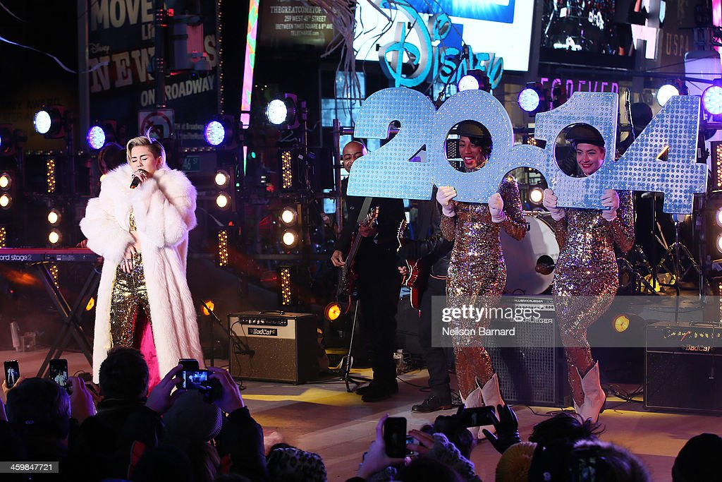 <a gi-track='captionPersonalityLinkClicked' href=/galleries/search?phrase=Miley+Cyrus&family=editorial&specificpeople=3973523 ng-click='$event.stopPropagation()'>Miley Cyrus</a> peforms on stage during The New Year's Eve 2014 Celebration in Times Square on December 31, 2013 in New York City.