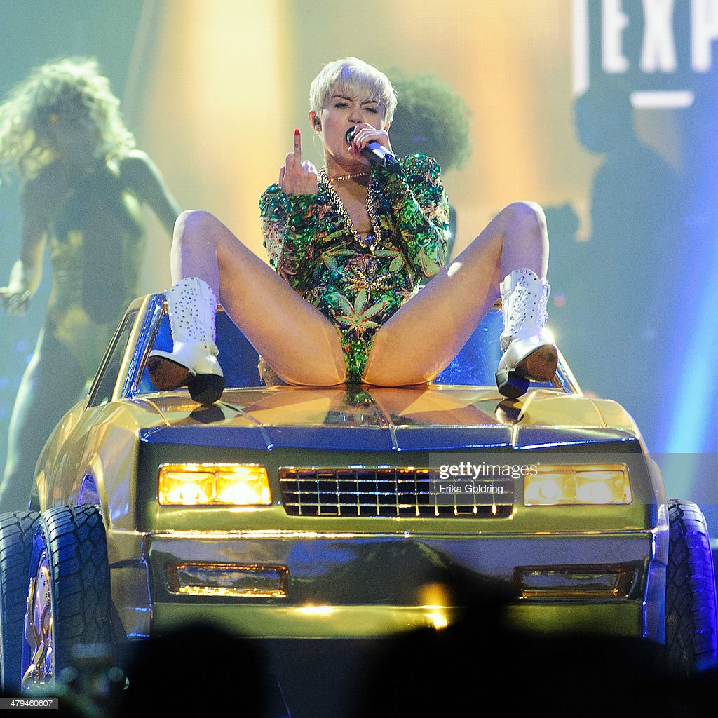 Miley Cyrus performs at Smoothie King Center on March 18 2014 in New Orleans Louisiana