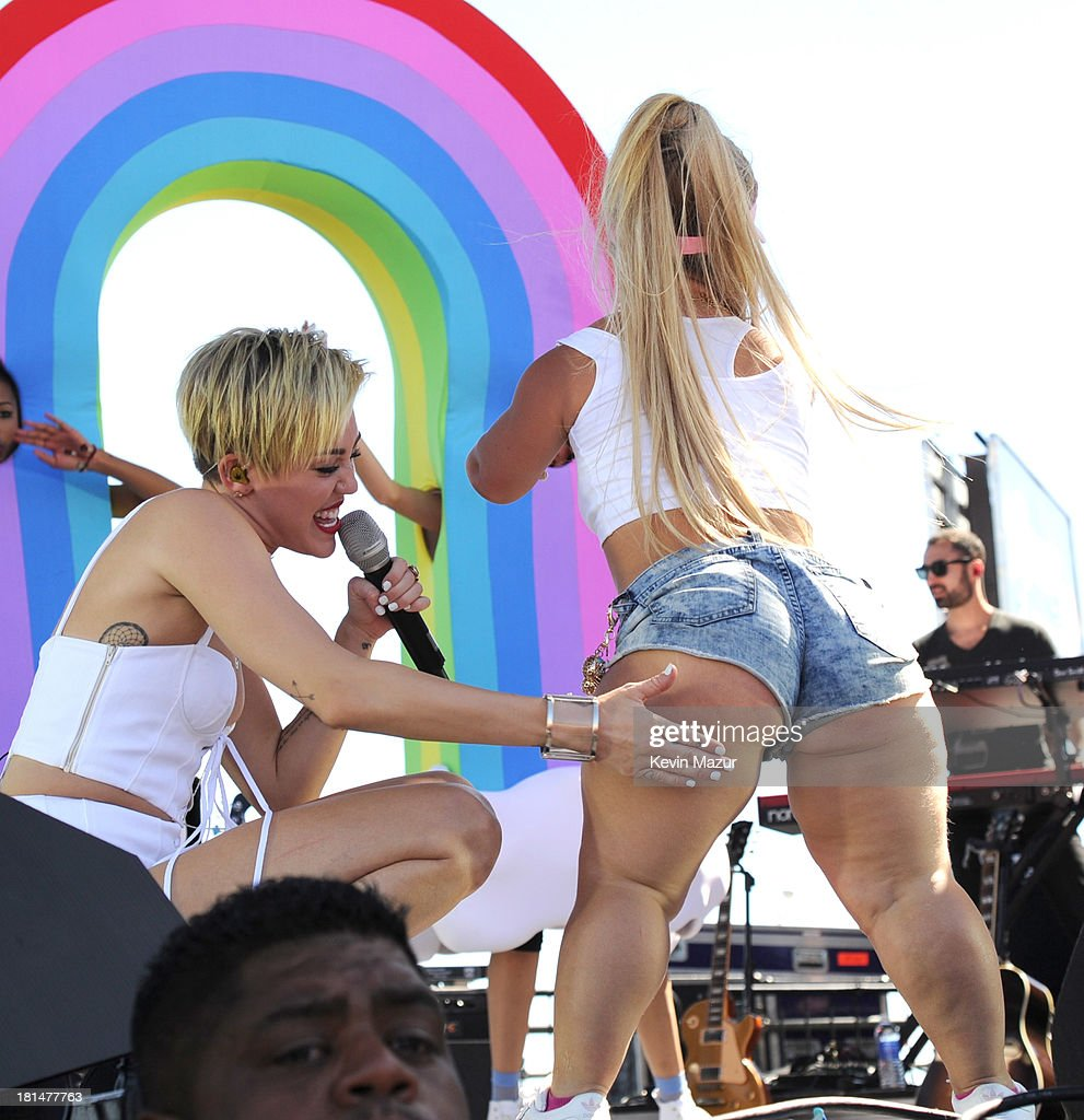 <a gi-track='captionPersonalityLinkClicked' href=/galleries/search?phrase=Miley+Cyrus&family=editorial&specificpeople=3973523 ng-click='$event.stopPropagation()'>Miley Cyrus</a> performs at the iHeartRadio Music Festival Village on September 21, 2013 in Las Vegas, Nevada.