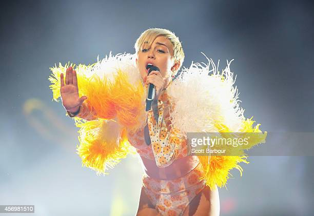 Miley Cyrus performs at the opening night of her Bangerz Tour in Australia at Rod Laver Arena on October 10 2014 in Melbourne Australia