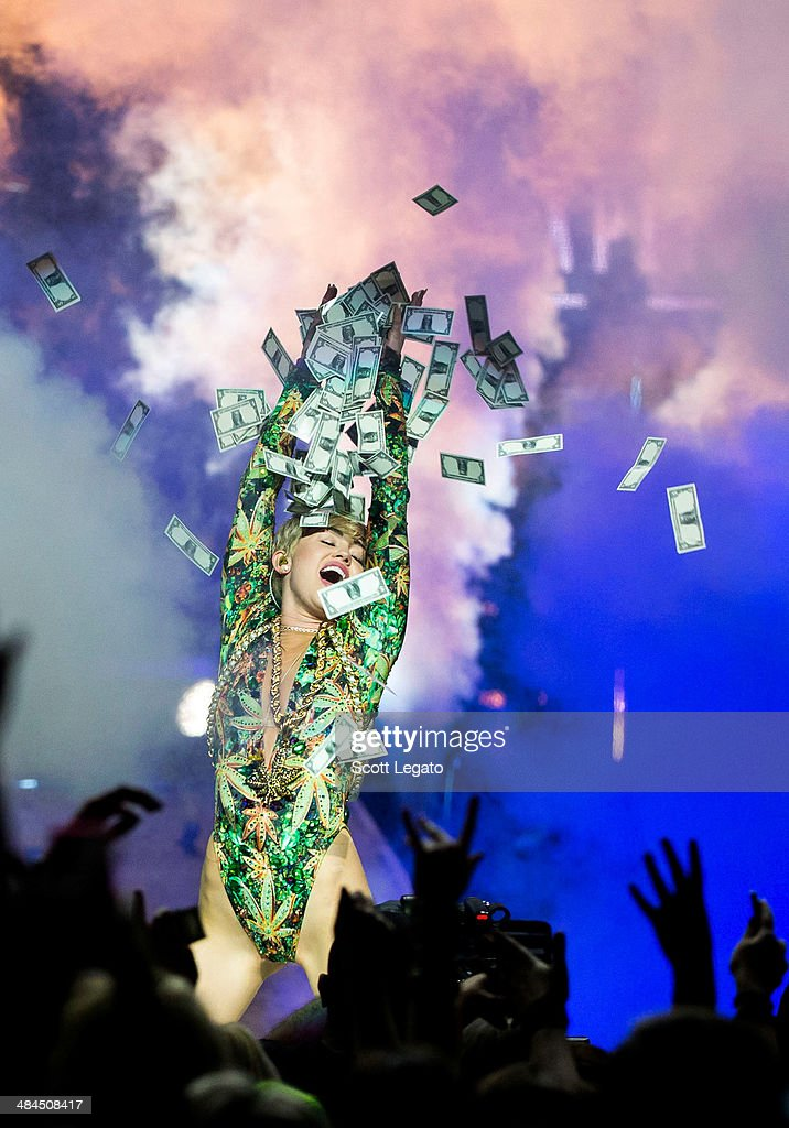 Miley Cyrus performs during her Bangerz Tour at The Palace of Auburn Hills on April 12, 2014 in Auburn Hills, Michigan.