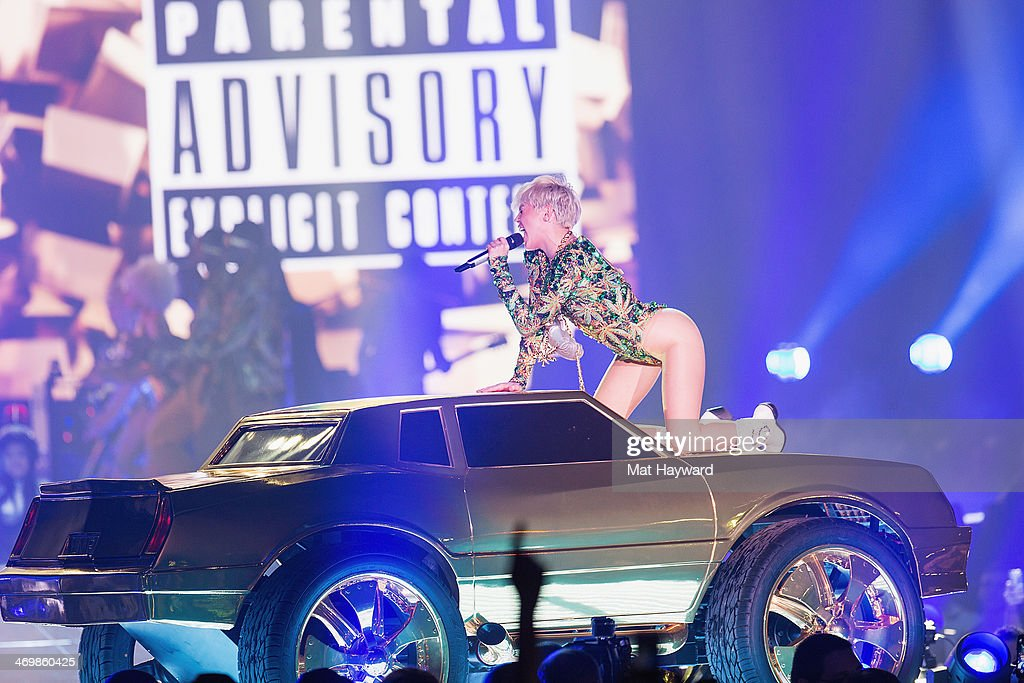 <a gi-track='captionPersonalityLinkClicked' href=/galleries/search?phrase=Miley+Cyrus&family=editorial&specificpeople=3973523 ng-click='$event.stopPropagation()'>Miley Cyrus</a> performs on stage during her 'Bangerz Tour' at the Tacoma Dome on February 16, 2014 in Tacoma, Washington.