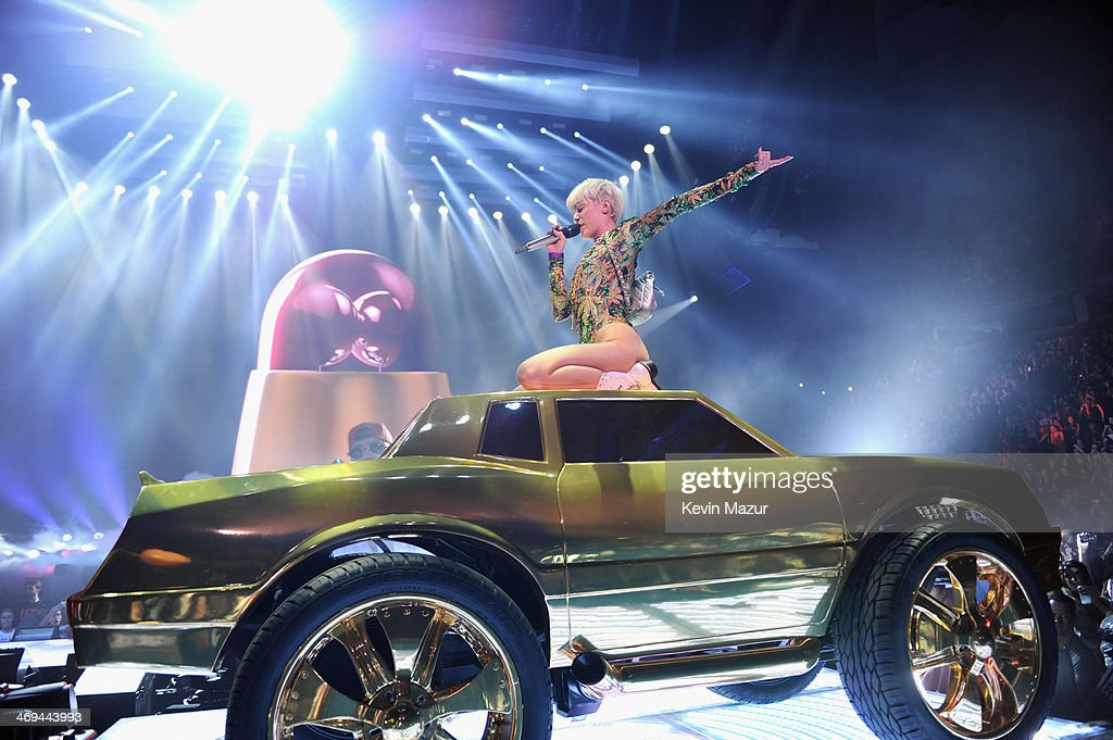 Miley Cyrus performs onstage during her 'Bangerz' tour at Rogers Arena on February 14, 2014 in Vancouver, Canada.