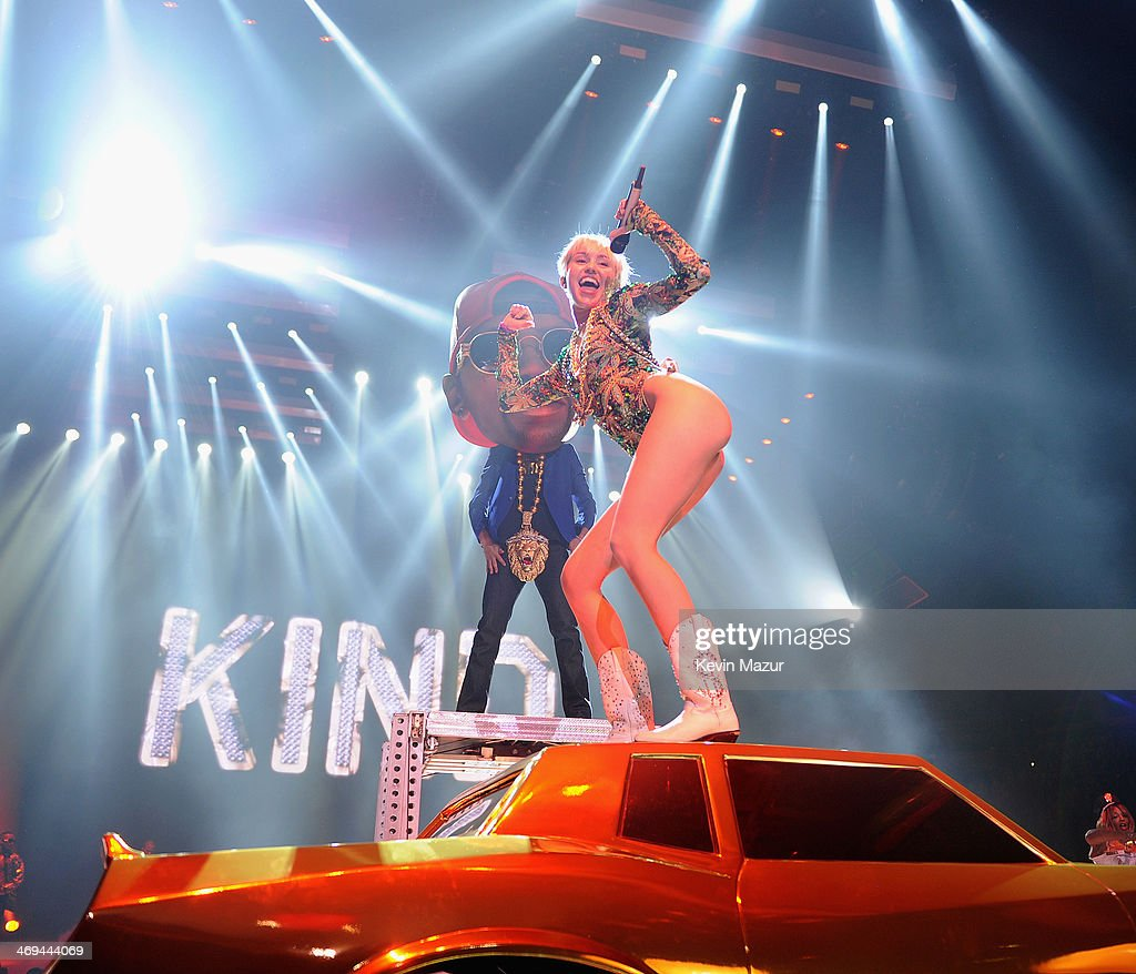 <a gi-track='captionPersonalityLinkClicked' href=/galleries/search?phrase=Miley+Cyrus&family=editorial&specificpeople=3973523 ng-click='$event.stopPropagation()'>Miley Cyrus</a> performs onstage during her 'Bangerz' tour at Rogers Arena on February 14, 2014 in Vancouver, Canada.