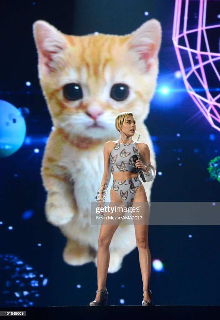 <a gi-track='captionPersonalityLinkClicked' href=/galleries/search?phrase=Miley+Cyrus&family=editorial&specificpeople=3973523 ng-click='$event.stopPropagation()'>Miley Cyrus</a> performs onstage during the 2013 American Music Awards at Nokia Theatre L.A. Live on November 24, 2013 in Los Angeles, California.