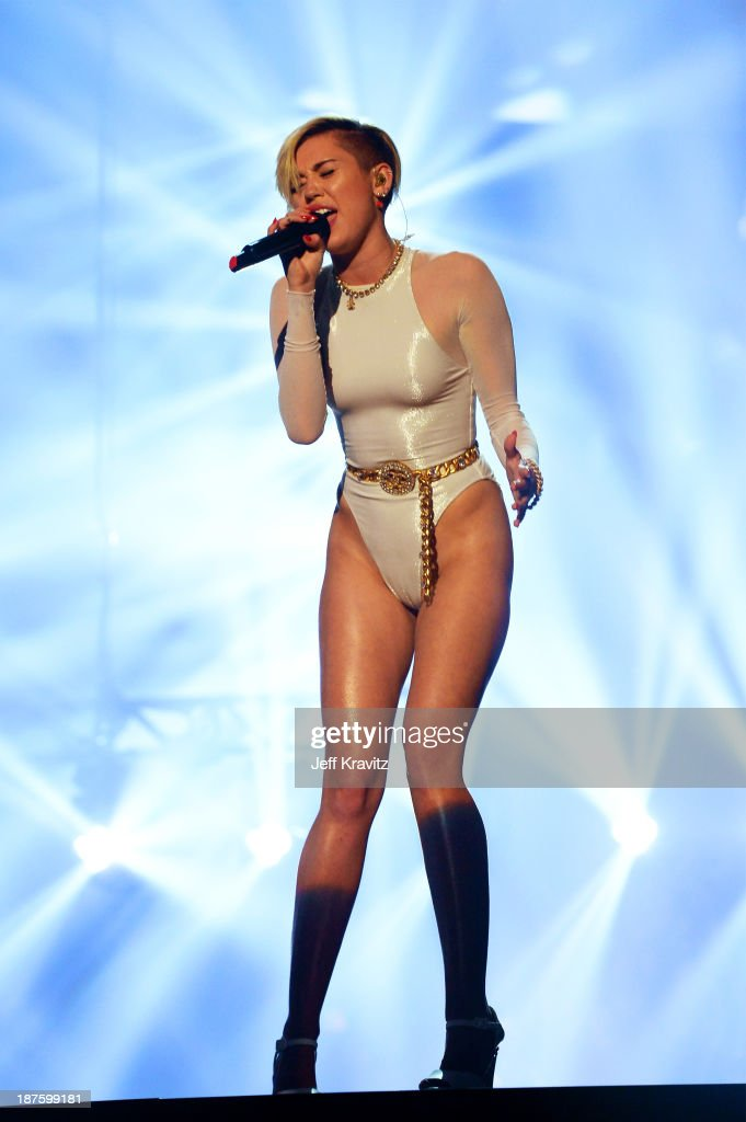<a gi-track='captionPersonalityLinkClicked' href=/galleries/search?phrase=Miley+Cyrus&family=editorial&specificpeople=3973523 ng-click='$event.stopPropagation()'>Miley Cyrus</a> performs onstage during the MTV EMA's 2013 at the Ziggo Dome on November 10, 2013 in Amsterdam, Netherlands.