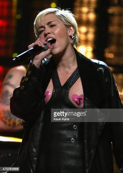 Miley Cyrus performs with Joan Jett and the Blackhearts onstage during the 30th Annual Rock And Roll Hall Of Fame Induction Ceremony at Public Hall...
