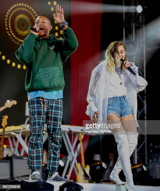 Miley Cyrus performs with Pharrell Williams during the One Love Manchester concert at Old Trafford Cricket Ground Cricket Club on June 4 2017 in...